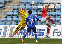 Charlton goalkeeper, Ben Amos, leaps forward to punch the ball clear during Gillingham vs Charlton Athletic, Sky Bet EFL League 1 Football at the MEMS Priestfield Stadium on 21st November 2020