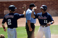 Outfielder Zach Kirksey #11 of the Ole Miss Rebels is greeted by teammate Alex Yarbrough #2 after he scored a run during the NCAA Regional baseball game against the Texas Christian University Horned Frogs on June 1, 2012 at Blue Bell Park in College Station, Texas. Ole Miss defeated TCU 6-2. (Andrew Woolley/Four Seam Images).