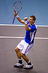 BANGKOK, THAILAND - OCTOBER 02:  Jarkko Nieminen of Finland celebrates match point against Benjamin Becker of Germany during the Day 8 of the PTT Thailand Open at Impact Arena on October 2, 2010 in Bangkok, Thailand.  Photo by Victor Fraile / The Power of Sport Images