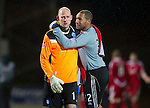 St Johnstone v Aberdeen...13.12.11   SPL .A gutted Peter Enckelman at full time with Jason Brown.Picture by Graeme Hart..Copyright Perthshire Picture Agency.Tel: 01738 623350  Mobile: 07990 594431