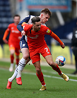 20th March 2021; Deepdale Stadium, Preston, Lancashire, England; English Football League Championship Football, Preston North End versus Luton Town; Liam Lindsay of Preston North End nd Harry Cornick of Luton Town compete for the ball