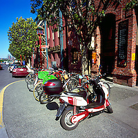 Victoria, BC, Vancouver Island, British Columbia, Canada - Scooters and Bicycles parked on Sidewalk in Old Town Shopping District