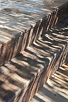 Rustic wooden steps lead down from the terrace