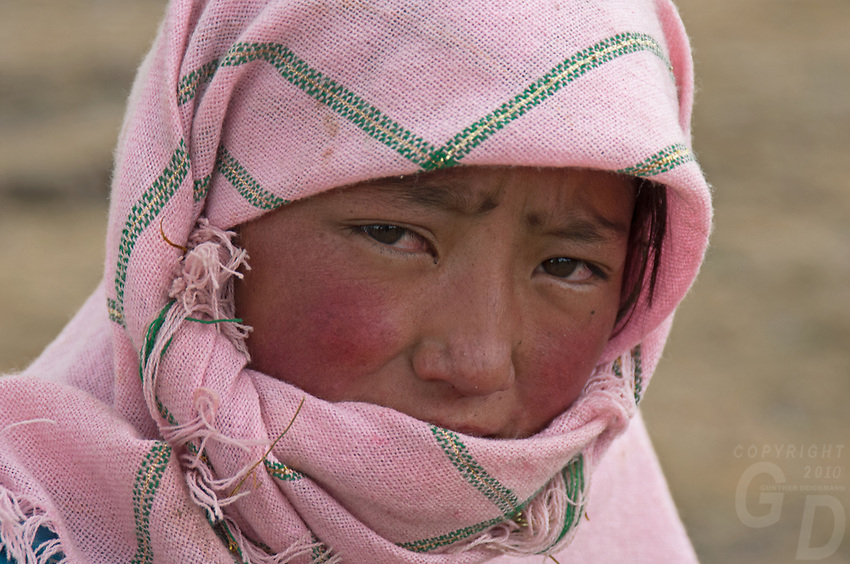 Portrait of Tibetan Nomad Children with their colourful headscarf near Lake Namtso, Tibet, China.