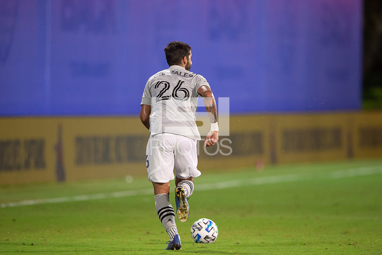 LAKE BUENA VISTA, FL - JULY 25: Jorge Corrales #26 of the Montreal Impact dribbles the ball during a game between Montreal Impact and Orlando City SC at ESPN Wide World of Sports on July 25, 2020 in Lake Buena Vista, Florida.