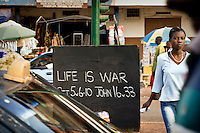 An artist's interpretation of a biblical passage written on a blackboard on a street in Berekum. Everyday, a local artist writes something on this passage which often reflects the desperation of the local youth.