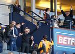 Motherwell manager Stephen Robinson celebrates in the stand at full time