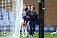 CHAPEL HILL, NC - NOVEMBER 29: Emily Fox #11 of the University of North Carolina is carried off the field by teammate Claudia Dickey #0 and a trainer after suffering a knee injury during a game between University of Southern California and University of North Carolina at UNC Soccer and Lacrosse Stadium on November 29, 2019 in Chapel Hill, North Carolina.