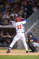 Jose Adolis Garcia Arrieta (32) of the Cuban National Team at bat against the US Collegiate National Team at BB&T BallPark on July 4, 2015 in Charlotte, North Carolina.  The United State Collegiate National Team defeated the Cuban National Team 11-1.  (Brian Westerholt/Four Seam Images)