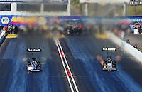 Feb. 18, 2012; Chandler, AZ, USA; NHRA top fuel dragster driver Shawn Langdon (left) races alongside Tony Schumacher during qualifying for the Arizona Nationals at Firebird International Raceway. Mandatory Credit: Mark J. Rebilas-