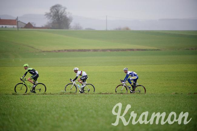 race leaders Dylan van Baarle (NLD/Cannondale-Garmin), Michal Kwiatkowski (POL/Ettix-Quickstep) & Edward Theuns (BEL/TopsportVlaanderen-Baloise) in the finale of the race <br /> (later winner) Jelle Wallays (BEL/Topsport Vlaanderen-Baloise) rides just in front of them<br /> <br /> 70th Dwars Door Vlaanderen 2015