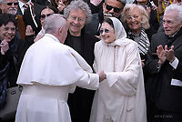 Pope Francis  salutes former Italian ballet dancers Carla Fracci at the end of his weekly general audience in St Peter's square at the Vatican on April 26, 2017.