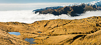 Views along alpine ridges with tarns. Tasman Sea under clouds, Westland Tai Poutini National Park, UNESCO World Heritage Area, West Coast, New Zealand, NZ