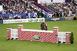 August 08, 2009: Peter Postelmans (NED) aboard Ajoor jump the wall. Land Rover International Puissance. Failte Ireland Horse Show. The RDS, Dublin, Ireland.