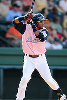 Second baseman Wendell Rijo (11) of the Greenville Drive bats in a game against the West Virginia Power on Sunday, May 11, 2014, at Fluor Field at the West End in Greenville, South Carolina. Rijo is the No. 18 prospect of the Boston Red Sox, according to Baseball America. Greenville won, 9-6. (Tom Priddy/Four Seam Images)