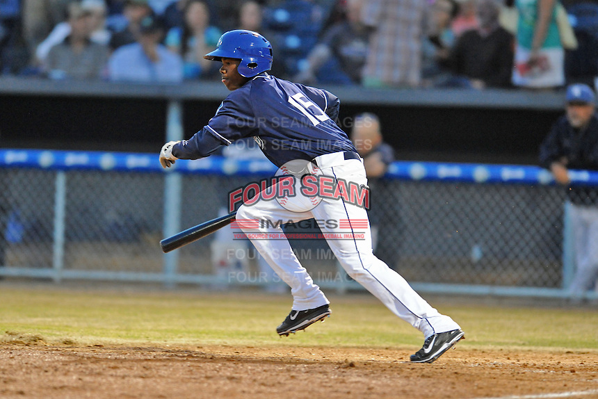 Asheville Tourists left fielder Raimel Tapia #15 runs to first during opening night game against the Delmarva Shorebirds at McCormick Field on April 3, 2014 in Asheville, North Carolina. The Tourists defeated the Shorebirds 8-3. (Tony Farlow/Four Seam Images)