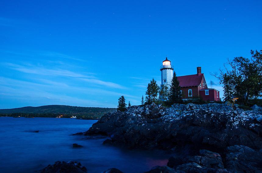 A view of the historic Eagle Harbor Lighthouse taken at dusk along the Lake Superior shoreline. Eagle Harbor, MI