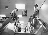 1966 File - <br /> <br /> Boys would rather ride handrails than stand on steps and are likely to become injury statistics.<br /> <br /> Photo : Boris Spremo - Toronto Star archives - AQP