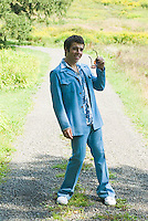 Man in blue leisure suit posing to camera<br />