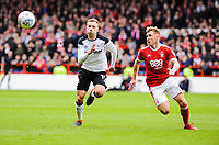 Nottingham Forest's forward Ben Osborn (11) gets in front of Derby County's forward Andi Weimann (19) as they chase the ball during the Sky Bet Championship match between Nottingham Forest and Derby County at the City Ground, Nottingham, England on 10 March 2018. Photo by Stephen Buckley / PRiME Media Images.