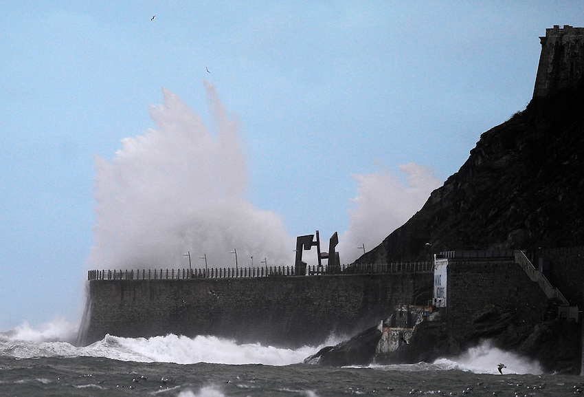 The waves hit the Basque coast in Donostia on February 1, 2014 in the Basque Country. A sculpture by Jorge Oteiza Basque sculptor placed on the new ride of Donostia suffers the consequences of maritime temporary. (Ander Gillenea / Bostok Photo)