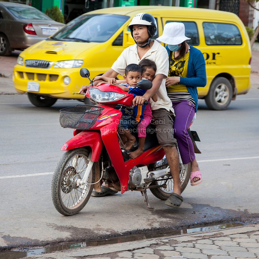 Cambodia, Family on a Motor Bike, Siem Reap Street Scene.