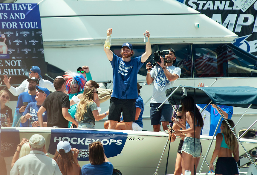 Former Moose Jaw Warrior Brayden Point, centre, celebrates the Tampa Bay Lightning's 2021 Stanley Cup Championship during a boat parade in Tampa on July 12, 2021.