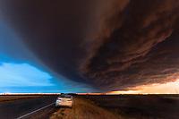 Thunderstorm Shelf Cloud at Sunset Above a Car in Kansas, June 15, 2012