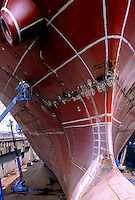 Chinese technicians examines the hull of a ship at the Hudong Zhonghua Shipbuilding Co., LTD in Shanghai, China. China is the world's third largest shipbuilding nation after South Korea and Japan. While growing international interest in its lower building cost and domestic tanker demand to fulfill the country's hunger for energy is likely to push the country to the top position, the rapidly increasing price of steel has also undercut the industry's profitability..