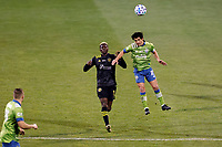 COLUMBUS, OH - DECEMBER 12: Nicolas Lodeiro #10 of Seattle Sounders FC battles for the ball against Gyasi Zardes #11 of Columbus Crew during a game between Seattle Sounders FC and Columbus Crew at MAPFRE Stadium on December 12, 2020 in Columbus, Ohio.