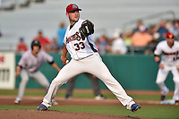 Tennessee Smokies starting pitcher Matt Loosen #33 delivers a pitch during a game against the Jacksonville Suns at Smokies Park July 10, 2014 in Kodak, Tennessee. The Suns defeated the Smokies 6-5. (Tony Farlow/Four Seam Images)