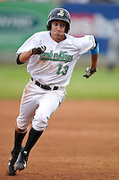 Aaron Barbosa #13 of the Clinton LumberKings scamper towards third base against the West Michigan Whitecaps at Ashford University Field on July  25, 2014 in Clinton, Iowa. The Whitecaps won 9-0.   (Dennis Hubbard/Four Seam Images)