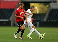 Lee Trundle of Swansea Legends (R) during the Alan Tate Testimonial Match, Swansea City Legends v Manchester United Legends at the Liberty Stadium, Swansea, Wales, UK