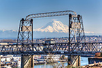 Historic Murray Morgan Bridge with Mt. Rainier in background, as seen from the south shore and Foss Waterway.  Commencement Bay's history of industry and shipping has led it to designation as a Superfund Cleanup Site and one of the most polluted waterways in the nation.  Commencement Bay Nearshore/Tideflats (CB/NT) Superfund Site.