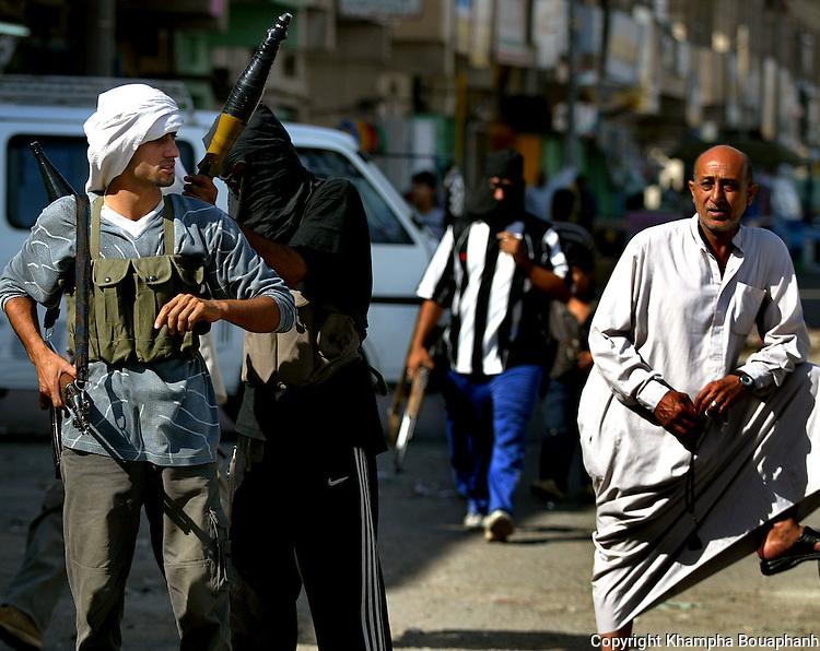 Shiite cleric Moqtada al-Sadr's Mehdi militiamen prepare for a U.S raid in Sadr City, Iraq  on May 25, 2004.  Sadr City is considered the slum of Baghdad where coalition forces clash with al-Sadr's Mehdi militia numerous times.
