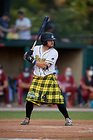 Savannah Bananas Logan Foster (14) bats during a Coastal Plain League game against the Macon Bacon on July 15, 2020 at Grayson Stadium in Savannah, Georgia.  Savannah wore kilts for their St. Patrick's Day in July promotion.  (Mike Janes/Four Seam Images)