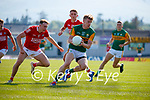Tommy Walsh, Kerry, in action against Sean Meehan, Cork, during the Munster GAA Football Senior Championship Final match between Kerry and Cork at Fitzgerald Stadium in Killarney on Sunday.