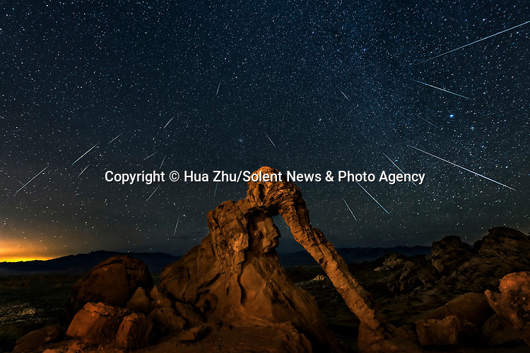 Pictured: The Milky Way at the Valley of Fire, California<br /> <br /> This beautiful series of photographs shows the Milky Way as seen from different continents around the world.   Photographer Hua Zhu travelled the globe over the course of four years to capture the starry night sky from already stunning locations. <br /> <br /> The medical professor visited picturesque landmarks in the USA, Kenya, New Zealand and China, including the Great Wall in Beijing.  Chinese Dr Zhu, who lives in New Jersey, USA, said he meticulously planned the trips by researching when the Milky Way would be on show.   SEE OUR COPY FOR DETAILS<br /> <br /> Please byline: Hua Zhu/Solent News<br /> <br /> © Hua Zhu/Solent News & Photo Agency<br /> UK +44 (0) 2380 458800