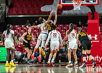 COLLEGE PARK, MD - FEBRUARY 13: Shakira Austin #1 of Maryland shoots over Kathleen Doyle #22 of Iowa during a game between Iowa and Maryland at Xfinity Center on February 13, 2020 in College Park, Maryland.