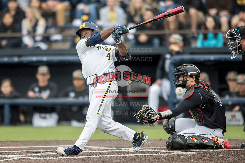 Michigan Wolverines second baseman Ako Thomas (4) swings the bat against the Maryland Terrapins on April 13, 2018 in a Big Ten NCAA baseball game at Ray Fisher Stadium in Ann Arbor, Michigan. Michigan defeated Maryland 10-4. (Andrew Woolley/Four Seam Images)