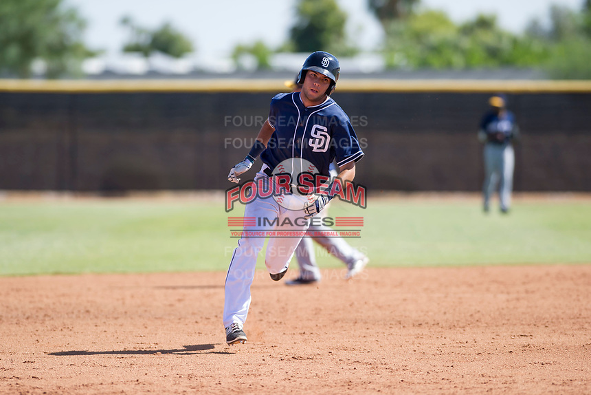 San Diego Padres shortstop Hudson Potts (10) hustles to third base during an Instructional League game against the Milwaukee Brewers on September 27, 2017 at Peoria Sports Complex in Peoria, Arizona. (Zachary Lucy/Four Seam Images)