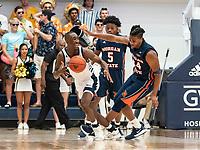WASHINGTON, DC - NOVEMBER 16: Mohamed Camara #14 of Morgan State and Shawn Walker Jr. #1 of George Washington clash during a game between Morgan State University and George Washington University at The Smith Center on November 16, 2019 in Washington, DC.