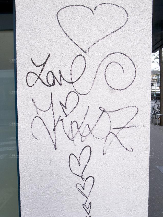 Switzerland. Canton Zürich. Zuerich. Graffiti on a white wall. Black hearts. 7.11.12  © 2012 Didier Ruef