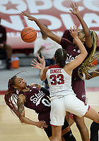 Arkansas guard Chelsea Dungee (33) collides Thursday, Feb. 11, 2021, with Mississippi State guard Jamya Mingo-Young (0) as center Jessika Carter (right) reaches to defend during the first half of play in Bud Walton Arena. Visit nwaonline.com/210212Daily/ for today's photo gallery. <br /> (NWA Democrat-Gazette/Andy Shupe)