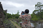 Man from Papua New Guinea taking photos in Micronesia with his iPad during a Climate Change Adaptation workshop
