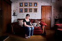 08/04/2009.Nuala Whelan with her pet dog Coby holding a photo of late husband John at her home in Windy Arbour, Dundrum, Dublin..John committed suicide leaving her to raise her family (pictured behind) on her own. beside her pet dog Coby at her home in Windy Arbour, Dundrum..Photo: Gareth Chaney Collins