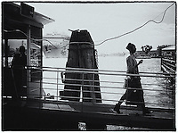 Woman walking across gangway