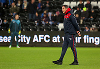 Swansea manager Paul Clement watches his players warm up prior to the Carabao Cup Fourth Round match between Swansea City and Manchester United at The Liberty Stadium, Swansea, Wales, UK. Tuesday 24 October 2017