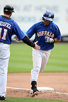 Buffalo Bisons second baseman Luis Hernandez #1 is congratulated by Tim Teufel #11 after hitting a grand slam during a game against the Indianapolis Indians at Coca-Cola Field on June 9, 2011 in Buffalo, New York.  Buffalo defeated Indianapolis 15-2.  Photo By Mike Janes/Four Seam Images