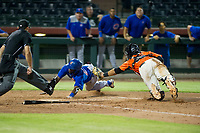 AZL Cubs shortstop Delvin Zinn (21) slides into home plate ahead of a tag by Ricardo Genoves (15) against the AZL Giants on September 5, 2017 at Scottsdale Stadium in Scottsdale, Arizona. AZL Cubs defeated the AZL Giants 10-4 to take a 1-0 lead in the Arizona League Championship Series. (Zachary Lucy/Four Seam Images)